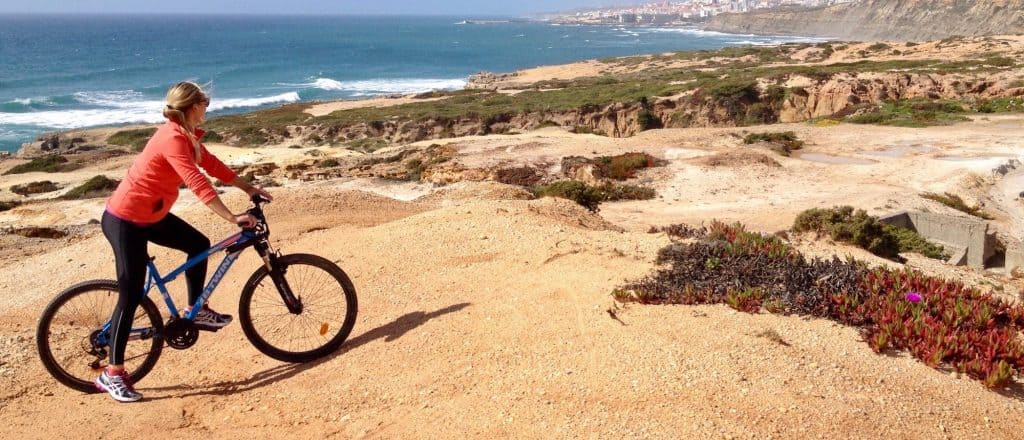 Girl on a mountain bike enjoying one of the trails in Ericeira