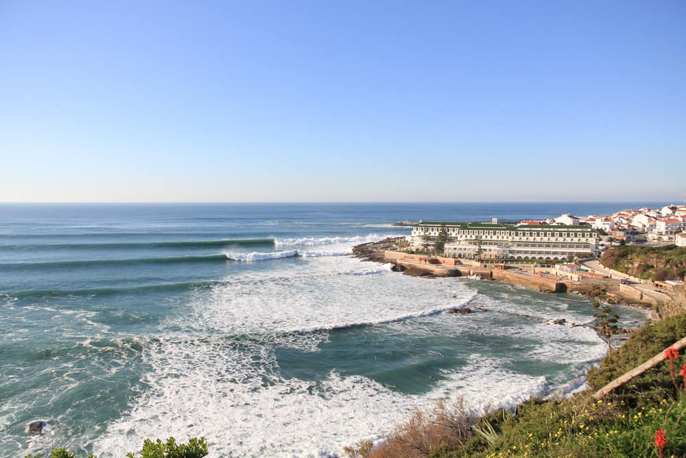 Waves breaking in front of the Vila Galé hotel in Ericeira at the surf spot Furnas