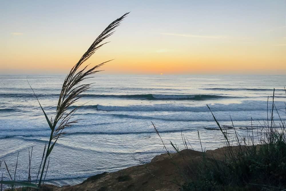 Surfers enjoying a nice sunset surf at Paparucos