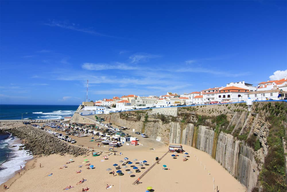 The harbour of Ericeira with its cozy beach and the village on top of the cliffs