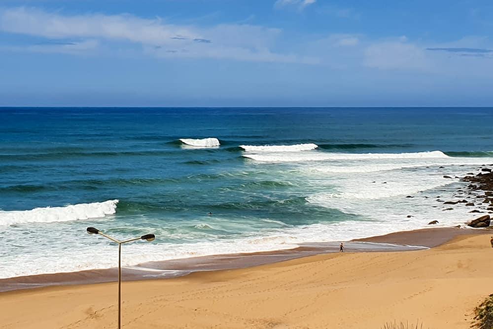 Waves breaking left and right at Praia da Calada