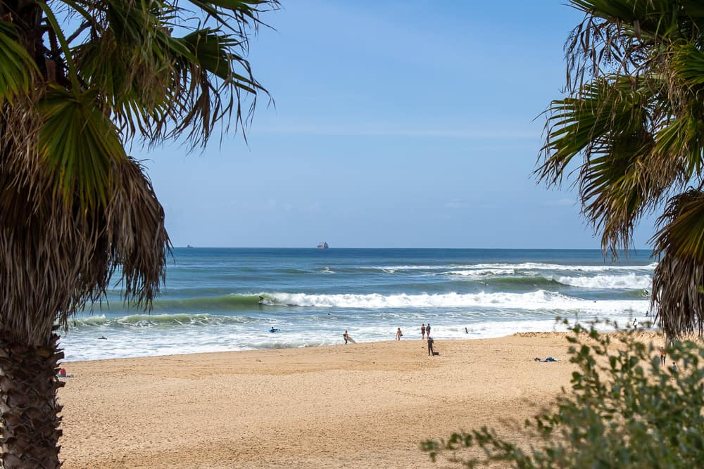 A typical day surfing the waves at Carcavelos beach
