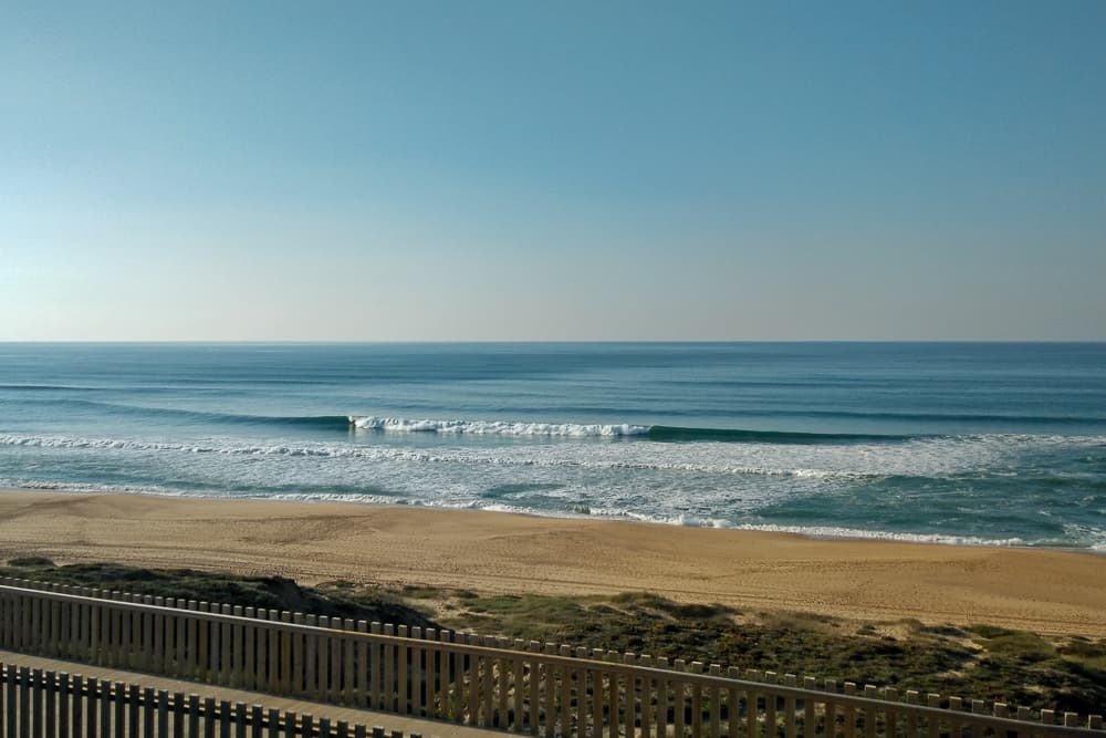 Glassy surf conditions at Praia Azul