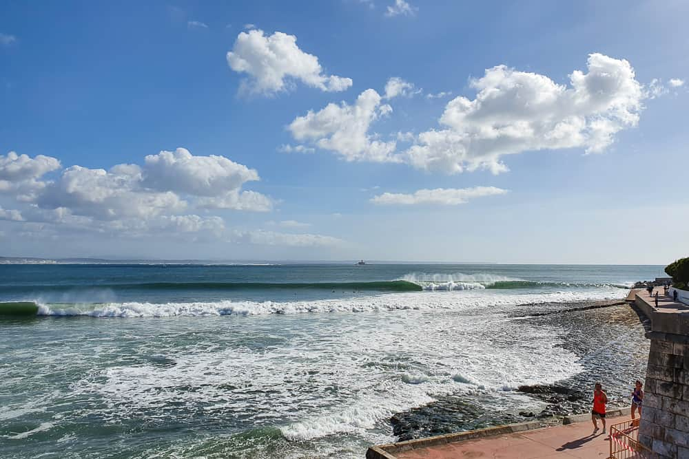 Surfers in the lineup at the amazing righthander of Praia da Santo Amaro