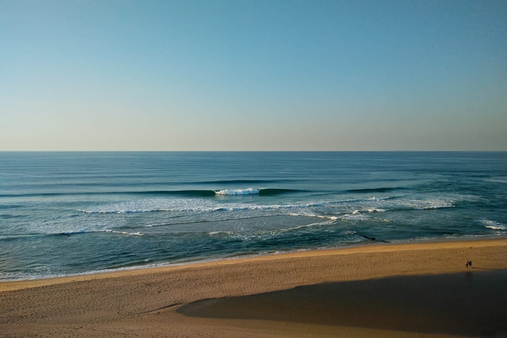 Few surfers enjoying perfect conditions at Praia de Santa Rita