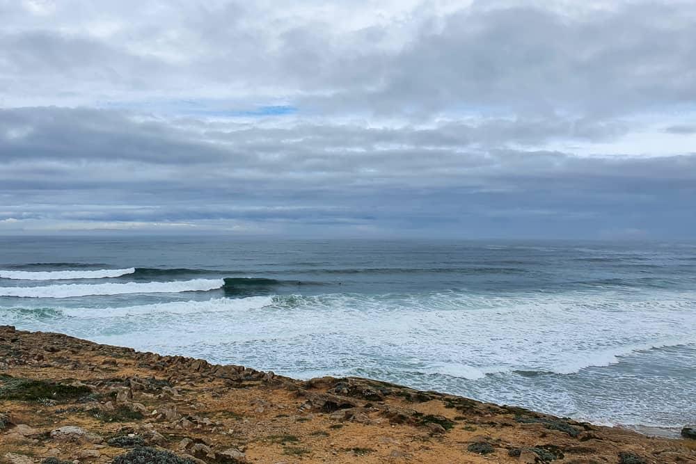 Waves breaking to the left at Praia da Cresmina