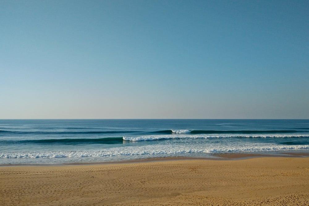 Glassy surf conditions at Praia da Aguda