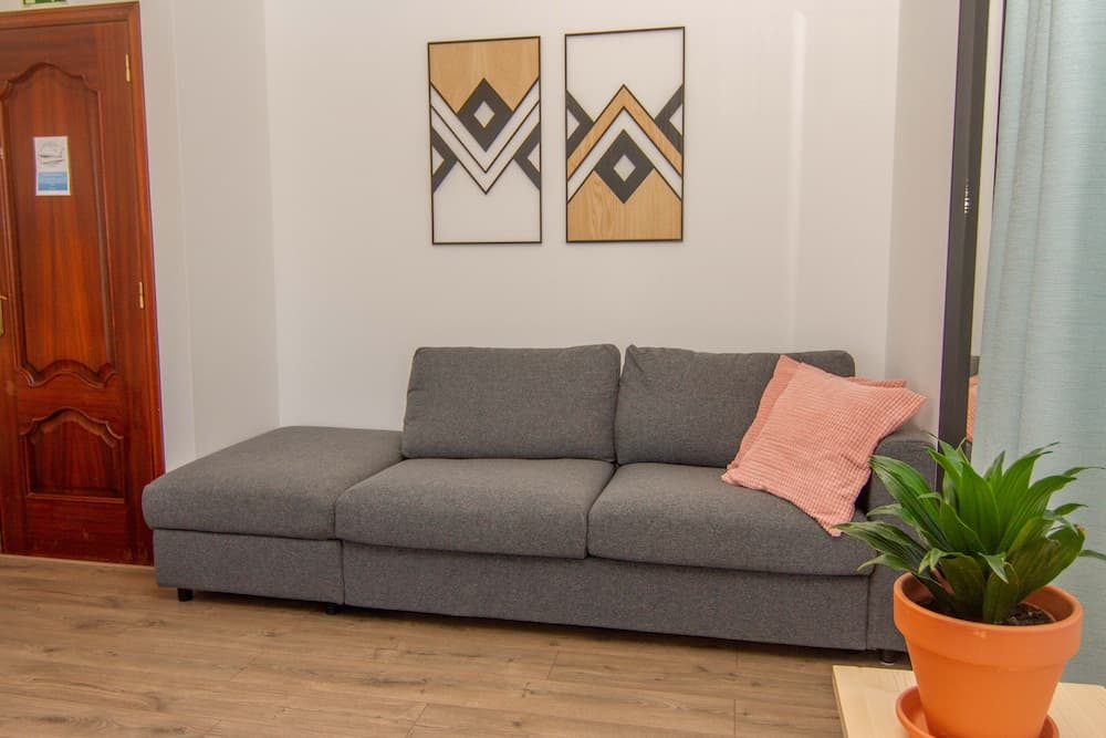 The couch in the family room can be converted in a sofa-bed for 2 persons