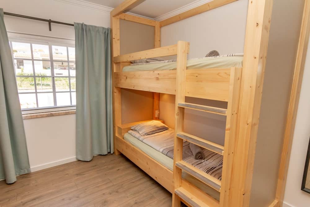 Handmade bunk bed with a small table, power socket and light with dimmer