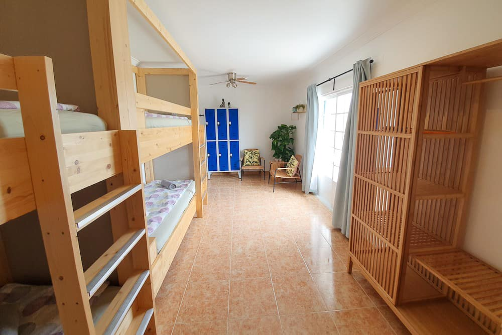 Spacious shared room with bunk beds, safe, closet, chairs and access to the balcony