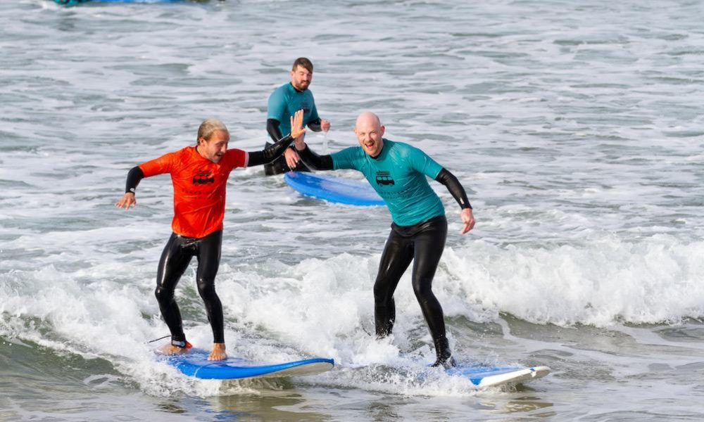 Happy faces during the first surf lesson in Ericeira Portugal
