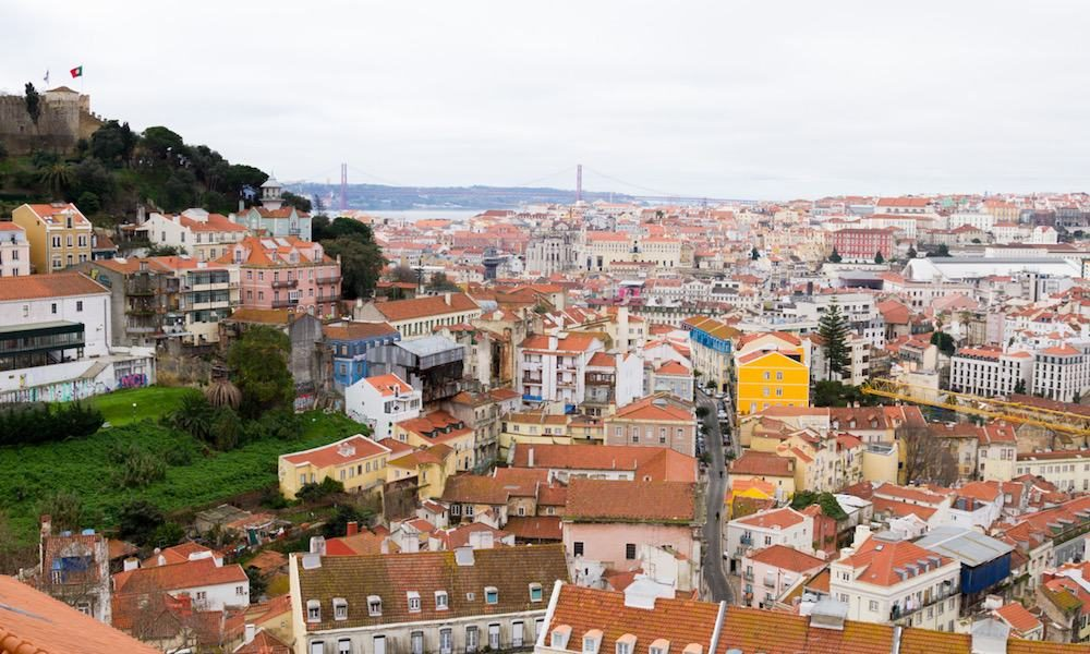 View over the city of Lisbon with in the background the Tagus river and Ponte 25 de Abril bridge
