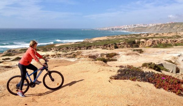Mountain biking on the coastline with Ericeira in the background